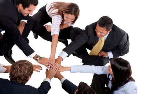 Business team with hands in the middle isolated