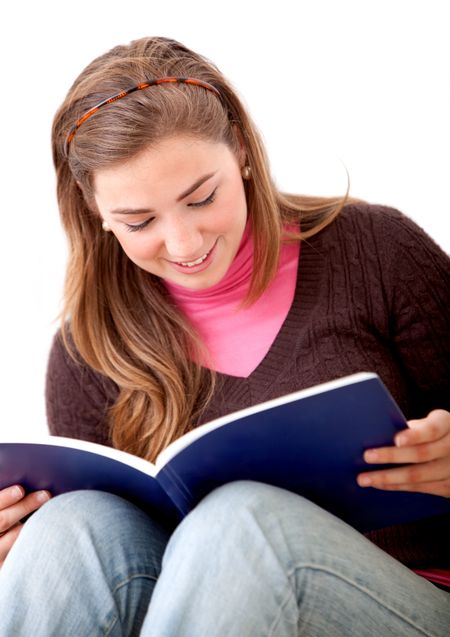 beautiful student smiling and reading a book - isolated over white
