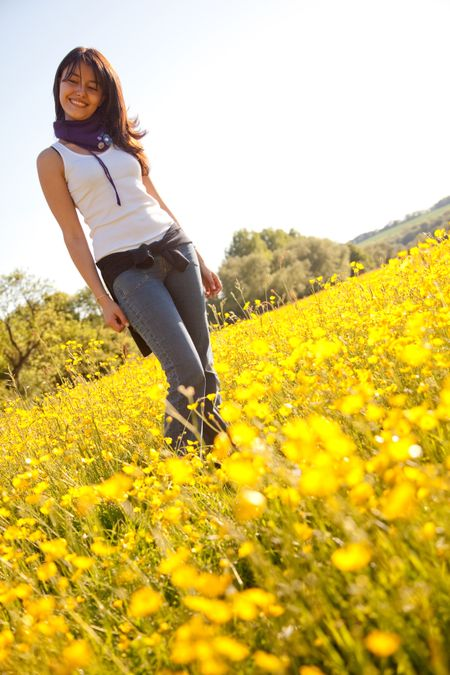 Beautiful woman smiling outdoors in a flower field