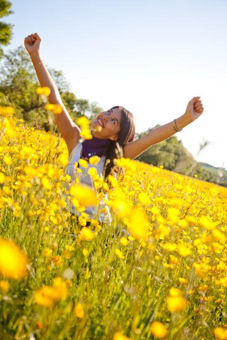 cheerful woman sitting on a beautiful meadow