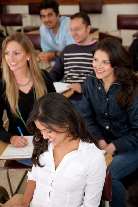 college or university students in a classroom studying