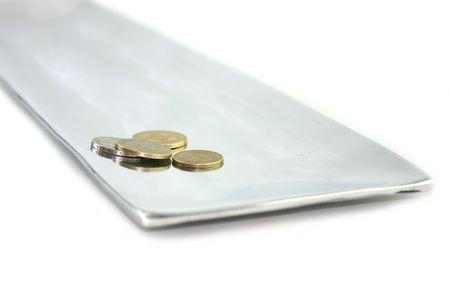 coins on an aluminium tray