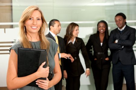 Business woman with a portfolio and her team