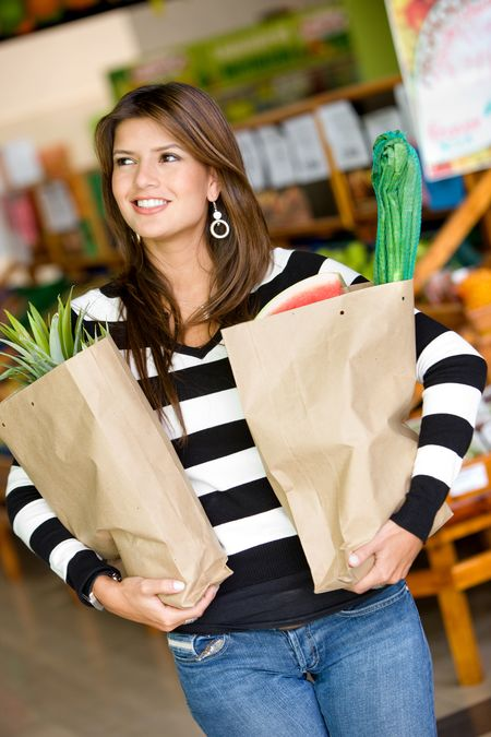woman in a supermarket with shopping bags