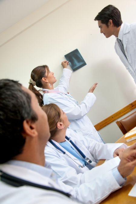 Group of doctors looking at an x ray picture