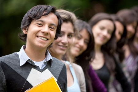 Group of students lined up outdoors smiling