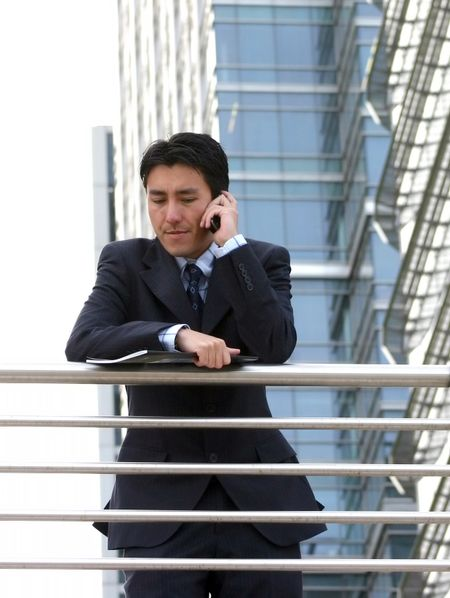 business man on the phone in a corporate environment