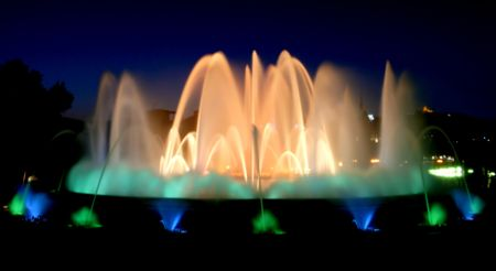 magic fountain in barcelona by the montjuic at night