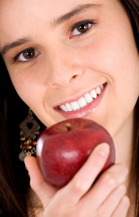 portrait of a girl holding an apple smiling