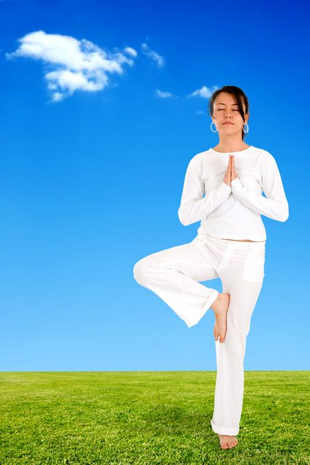 girl doing yoga meditation outdoors on a beautiful day