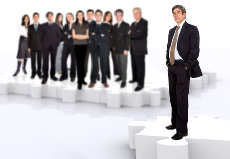 business leadership and teamwork with a businessman in front of a businessteam all standing on puzzle pieces