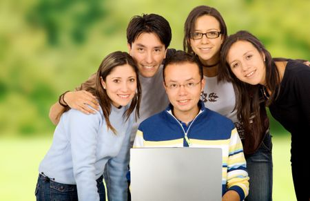 Casual group of students smiling outdoors in a park