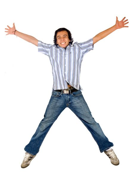 casual man jumping in the air with his arms open and a big smile on his face - isolated over a white background