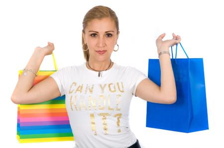 casual woman holding shopping bags - isolated over a white background