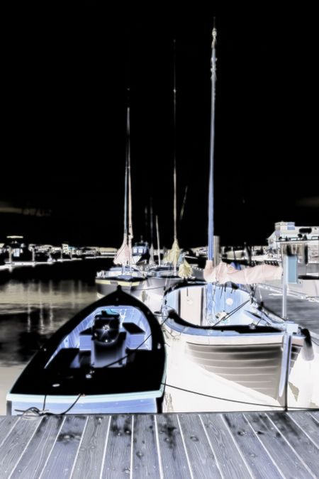 Nocturnal illustration of boats tied up in a coastal marina in the Pacific Northwest, with diffuse glow effect, for motifs of lifestyle or travel
