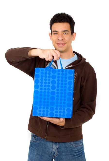 man with a blue shopping bag - isolated over a white background
