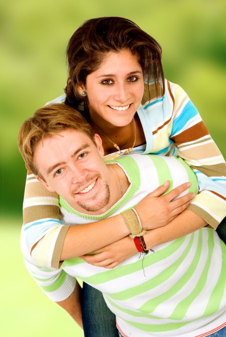 couple having fun outdoors on a green background
