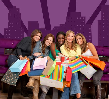 Group of beautiful girls with shopping bags in an urban scene
