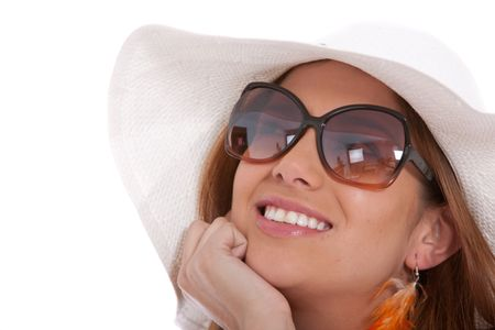 Fashionable woman wearing a hat and sunglasses isolated