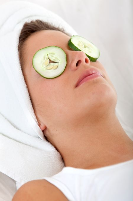 Relaxed woman with cucumber on her eyes