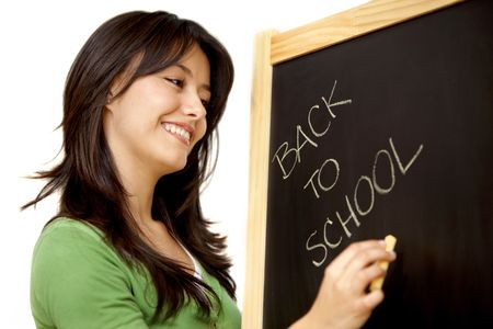 Woman writing 'back to school' in a chalkboard isolated