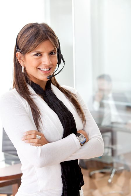 Business woman in an office with headset