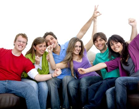 Happy group of people sitting on a couch isolated