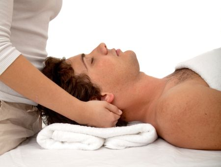Relaxed man getting a stress free massage isolated