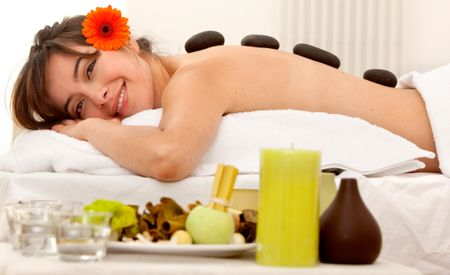 Beautiful woman relaxing at a spa smiling