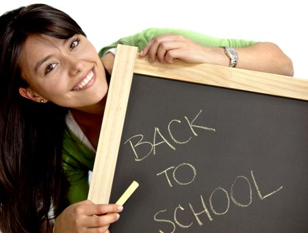 Woman writing 'back to school' on a chalkboard isolated