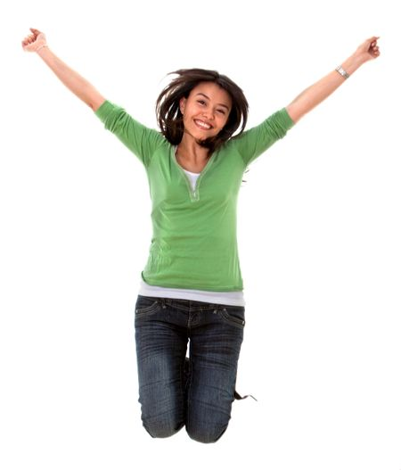 Happy casual woman jumping isolated over white