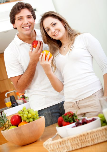 Beautiful healthy eating couple with fruits and vegetables