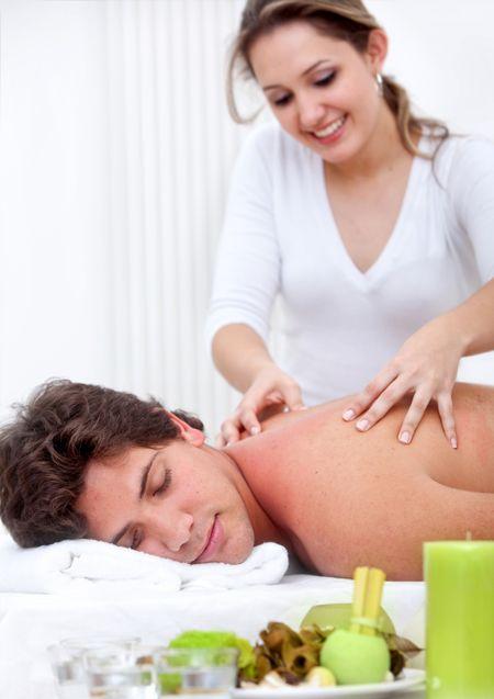 Man at a spa getting a stress-free massage