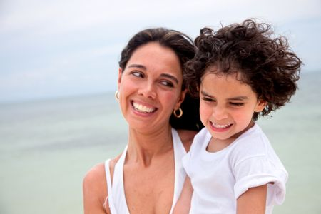 Portrait of a mother and her son at the beach