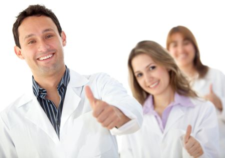 Group of doctors with thumbs-up isolated on white