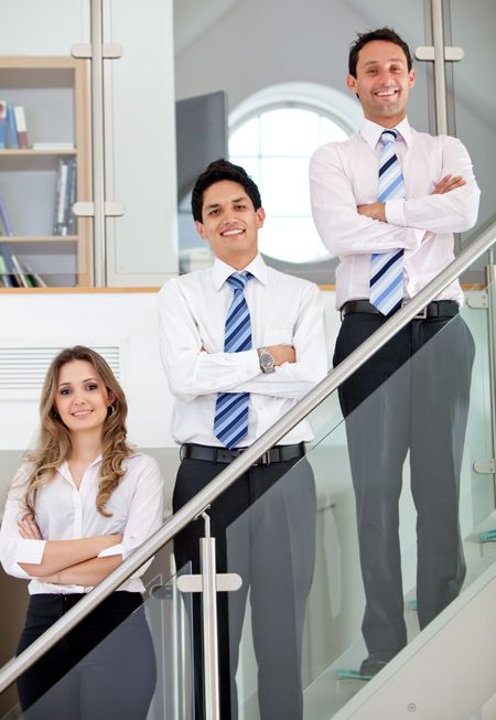 Young business team in an office smiling