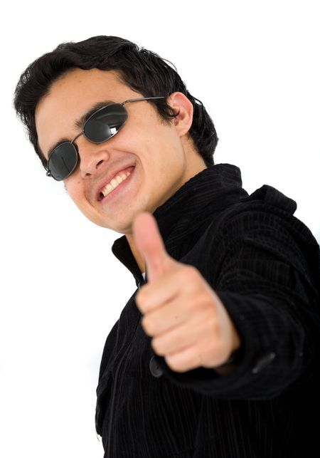positive and happy young man with his thumb up and wearing sunglasses