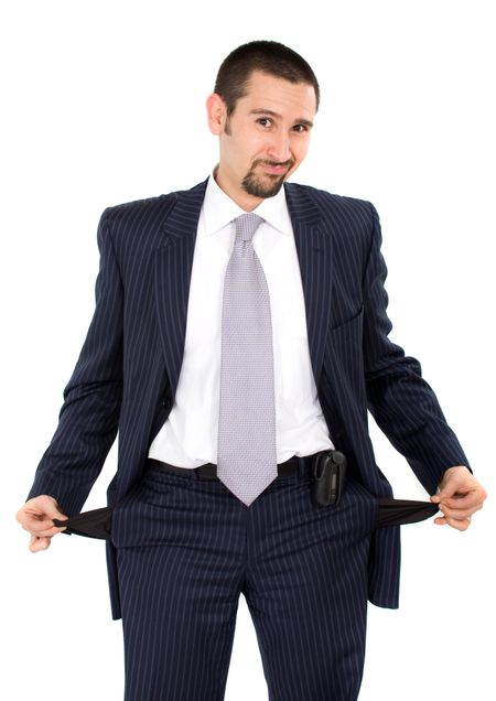 bankrupt business man with hands out of pockets over a white background