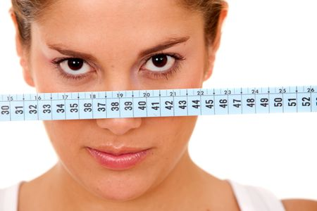 Woman face with a measuring tape isolated