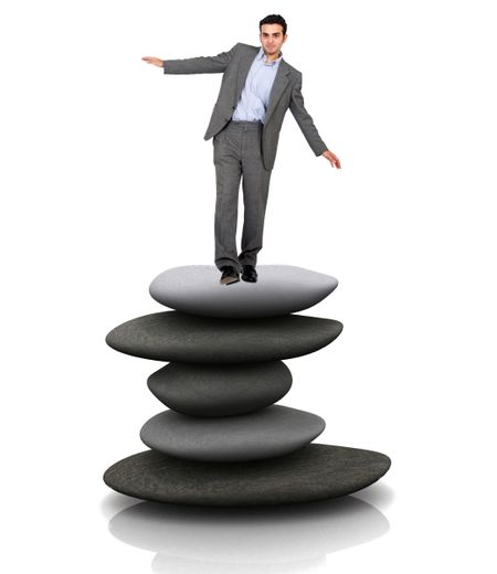 business man balancing over a pile of stones isolated