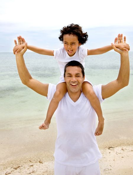 Beautiful portrait of a father and son at the beach