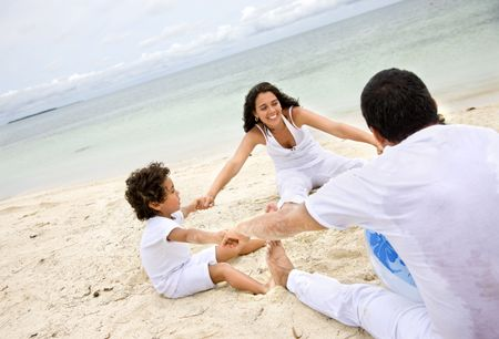 Happy family at the beach on vacations