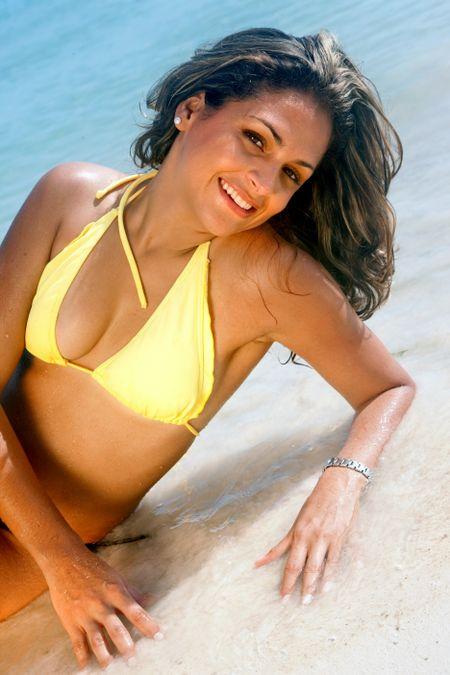 Bikini woman portrait lying on the beach