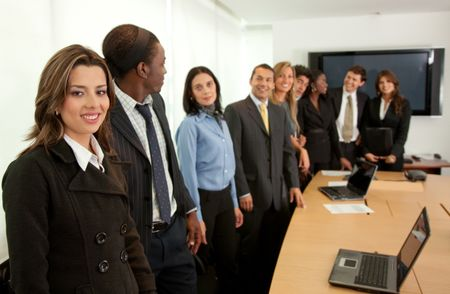 Large business group in a conference smiling