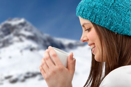 Happy winter woman with a hot drink
