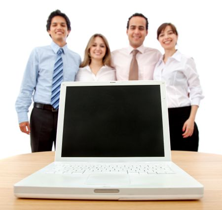 Business team with a laptop isolated on white