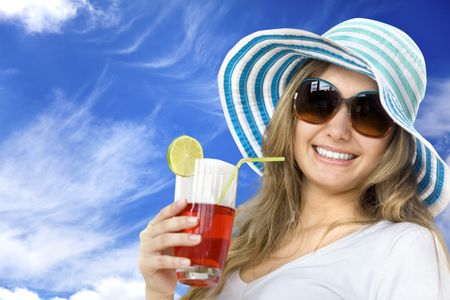 Summer woman with hat and a drink outdoors