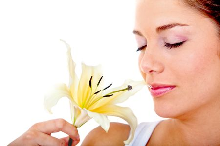 Beautiful woman portrait smelling a flower isolated