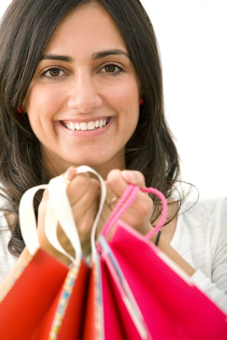 Woman portrait with shopping bags isolated on white