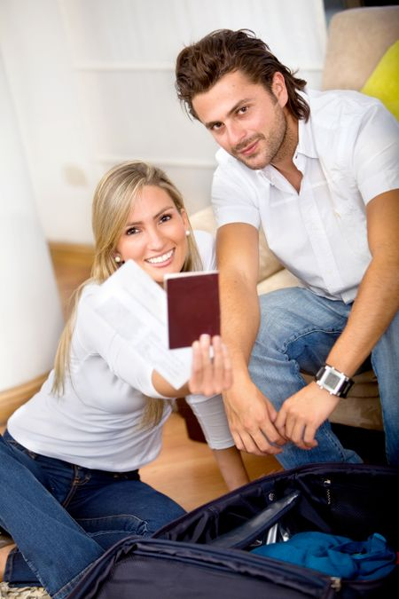 Young couple with passport getting ready to travel